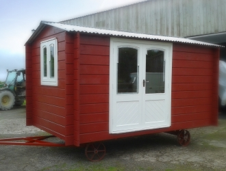 Red Bespoke Shepherd Hut Cornwall on trailer ready for delivery