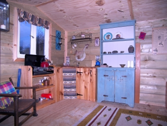 Red Shepherd Hut inside kitchen