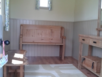 Wood clad Shepherd hut interior
