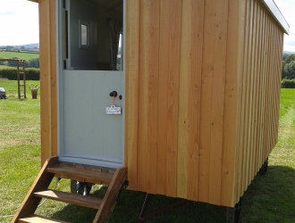 Wood clad Shepherd hut - front view (2)
